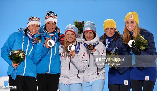 Silver medalists AinoKaisa Saarinen and Kerttu Niskanen of Finland gold medalists Ingvild Flugstad Oestberg and Marit Bjoergen of Norway and bronze...