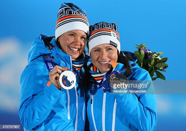 Silver medalists AinoKaisa Saarinen and Kerttu Niskanen of Finland celebrate during the medal ceremony for the Cross Country Ladies' Team Sprint on...
