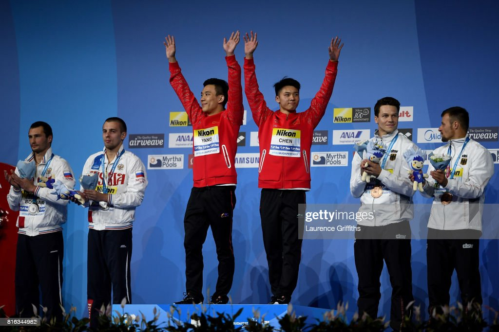 Silver medalists Aleksandr Bondar and Viktor Minibaev of Russia, gold medalists Aisen Chen and Hao Yang of China and bronze medalists Patrick Hausding and Sascha Klein of Germany pose with the medals won during the Men's Diving 10M Synchro Platform final on day four of the Budapest 2017 FINA World Championships on July 17, 2017 in Budapest, Hungary.