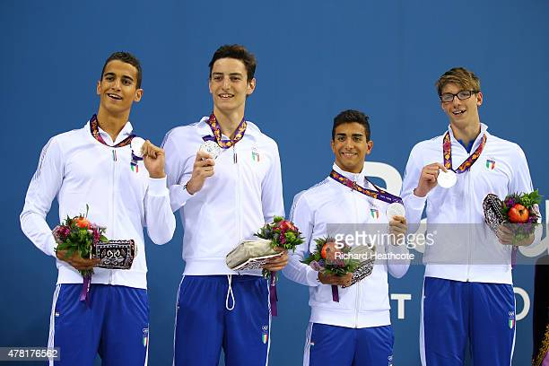 Silver medalists Alessandro Bori Ivano Vendrame Giovanni Izzo and Alessandro Miressi of Italy pose on the medal podium following the Men's Swimming 4...