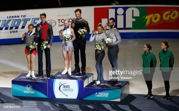Silver medalists Alisa Efimova and Alexander Korovin of Russia from left gold medalists Evgenia Tarasova and Vladimir Morozov of Russia and bronze...