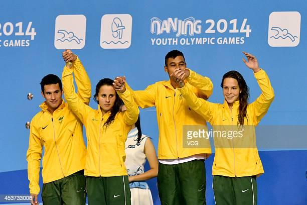 Silver medalists Altamir Lopes Melo Luiz De Luccas Natalia De Santana Matheus Paulo and Tomanik Diamante Giovanna of Brazil celebrate on the podium...