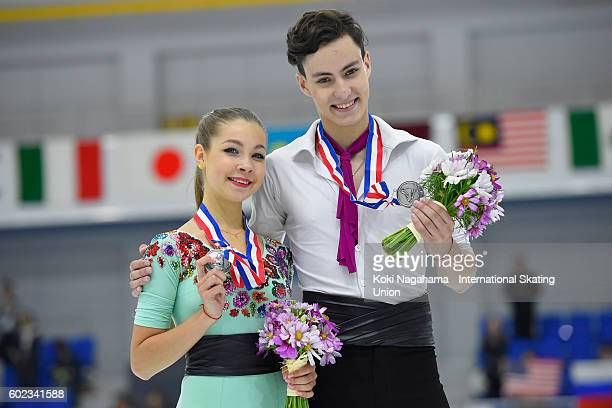 Silver medalists Anastasia Shpilevaya and Grigory Smirnov of Russia pose for photographs after the junior ice dance free dance during the ISU Junior...