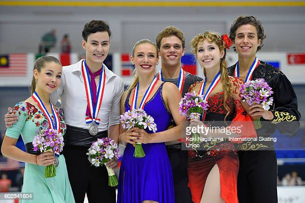 Silver medalists Anastasia Shpilevaya and Grigory Smirnov of Russia and Gold medalists Rachel Parsons and Michael Parsons of United States and Bronze...