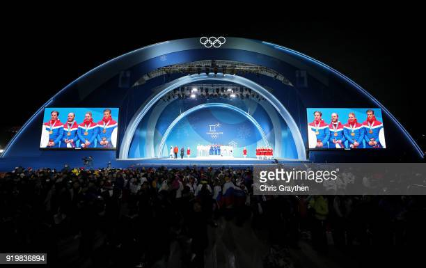Silver medalists Andrey Larkov Alexander Bolshunov Alexey Chervotkin and Denis Spitsov of Olympic Athlete from Russia gold medalists Didrik Toenseth...