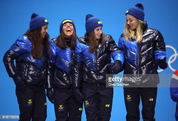 Silver medalists Anna Haag Charlotte Kalla Ebba Andersson and Stina Nilsson of Sweden celebrate during the medal ceremony for the CrossCountry...