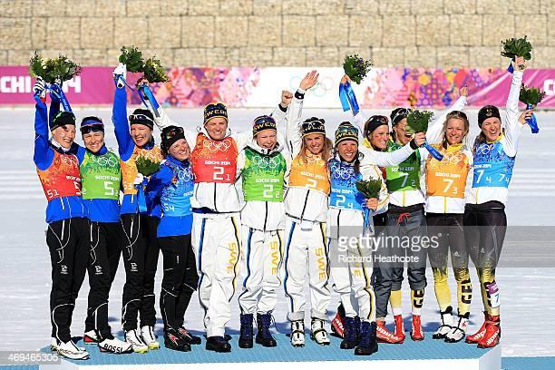 Silver medalists Anne Kylloenen AinoKaisa Saarinen Kerttu Niskanen and Krista Lahteenmaki of Finland gold medalists Ida Ingemarsdotter Emma Wiken...