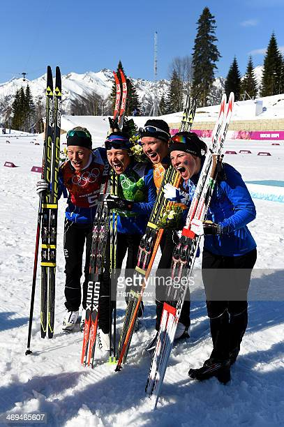 Silver medalists Anne Kylloenen AinoKaisa Saarinen Kerttu Niskanen and Krista Lahteenmaki of Finland celebrate during the flower ceremony for the...