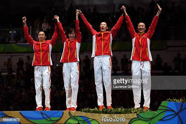 Silver medalists Anqi Xu Jialu Hao Yiwen Sun and Yuije Sun of China stand on the podium during the medal ceremony for the Women's Epee Team event on...