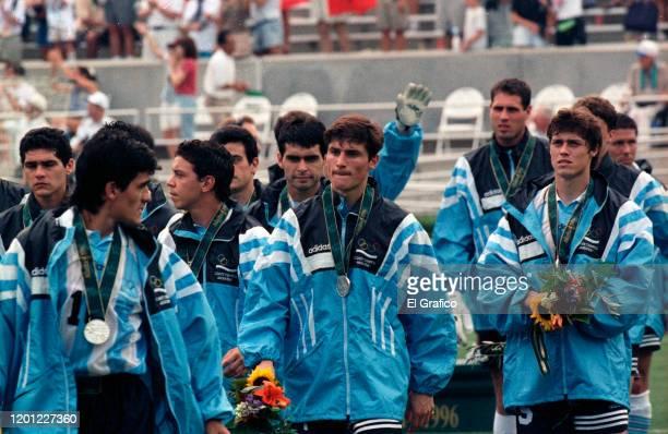 Silver medalists Ariel Ortega Marcelo Galardo Javier Zanetti and Matias Almeyda of Argentina react on the podium after the Men's Football Final...