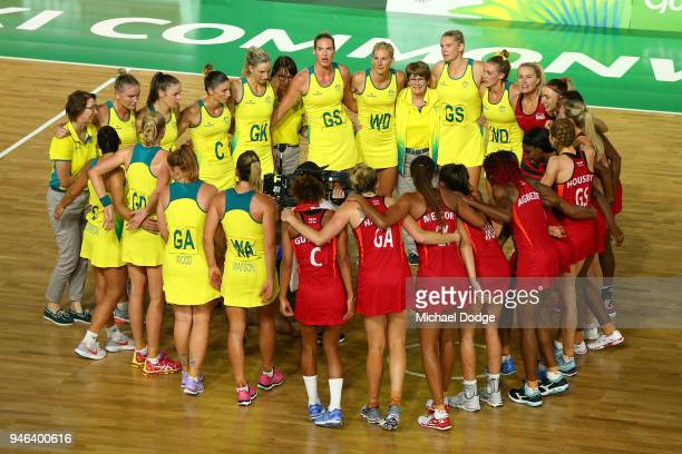 Silver medalists Australia and gold medalists England come together following the Netball Gold Medal Match on day 11 of the Gold Coast 2018...