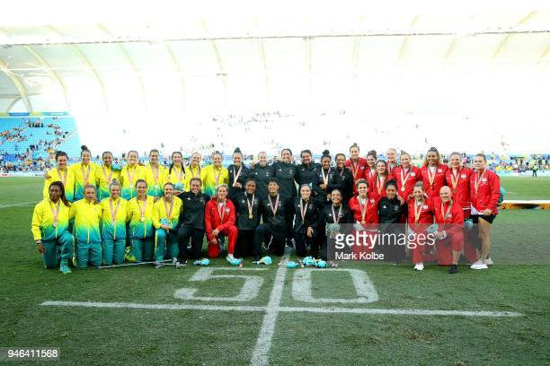 Silver medalists Australia gold medalists New Zealand and bronze medalists England pose during the medal ceremony for the Women's Gold Medal Rugby...