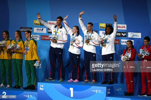 Silver medalists Australia gold medalists The United states and bronze medalists Canada pose with the medals won during the Mixed 4x100m Medley Relay...