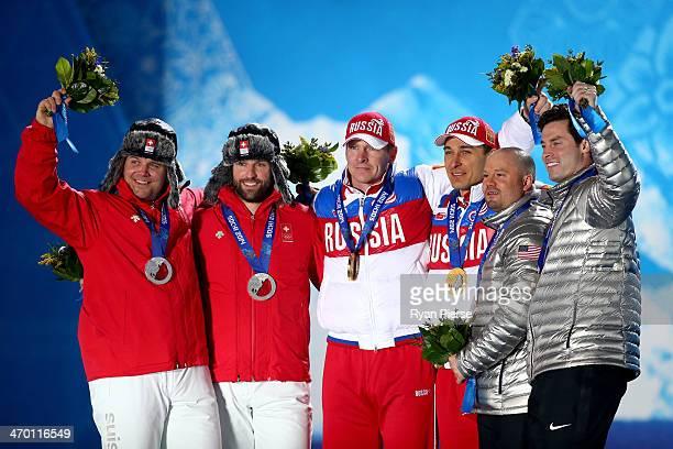 Silver medalists Beat Hefti and Alex Baumann of Switzerland team 1 gold medalists Alexander Zubkov and Alexey Voevoda of Russia team 1 and bronze...