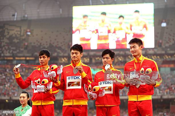Silver medalists Bingtian Su of China Zhenye Xie of China Peimeng Zhang of China and Youxue Mo of China pose on the podium during the medal ceremony...
