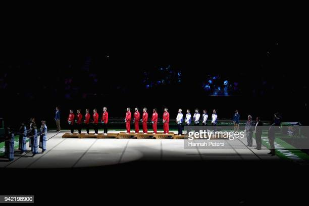 R Silver medalists Canada gold medalists England and bronze medalists Scotland stand on the podium during the medal ceremony for the Men's Team Final...