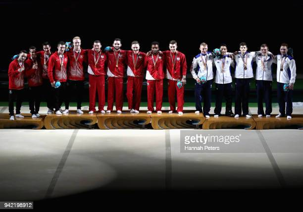 Silver medalists Canada, gold medalists England and bronze medalists Scotland stand on the podium during the medal ceremony for the Men's Team Final...