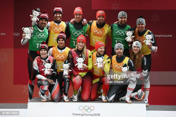 Silver medalists Canada gold medalists Germnay and bronze medalists Austria pose on the podium during the victory ceremony afterduring the Luge Team...
