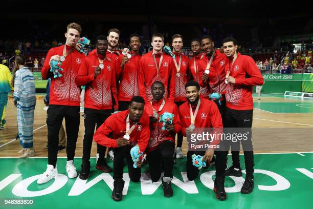 Silver medalists Canada pose during the medal ceremony for the Men's Gold Medal Basketball Game between Australia and Canada on day 11 of the Gold...