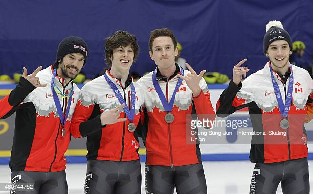 Silver medalists Charle Cournoyer Patrick Duffy Samuel Girard and Charles Hamelin of Canada pose for medal ceremomy in the Men's 5000M Relay Final A...