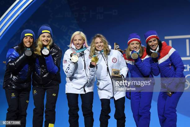 Silver medalists Charlotte Kalla and Stina Nilsson of Sweden gold medalists Jessica Diggins and Kikkan Randall of the United States and bronze...