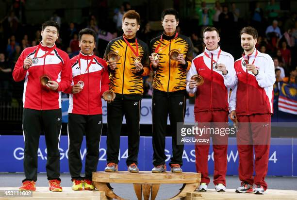 Silver medalists Chayut Triyachart and Danny Chrisnanta of Singapore, gold medalists Wee Kiong Tan and Mas Wei Shem of Malaysia and bronze medalists...