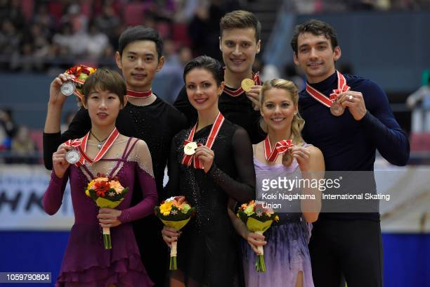 Silver medalists Cheng Peng and Yang Jin of China , gold medalists Natalia Zabiiako and Alexander Enbert of Russia and bronze medalists Alexa Scimeca...