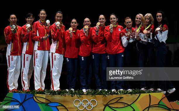 Silver medalists China gold medalists Romania and bronze medalists Russia stand on the podium during the medal ceremony for the Women's Epee Team...