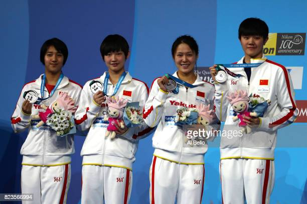 Silver medalists China pose with the medals won during the Womens 4x200m Freestyle final on day fourteen of the Budapest 2017 FINA World...
