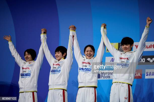Silver medalists China's Ai Yanhan China's Liu Zixuan China's Zhang Yuhan and China's Li Bingjie celebrate on the podium of the women's 4x200m...