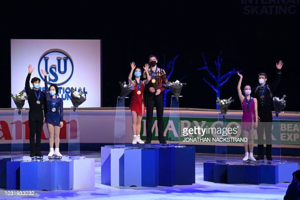 Silver medalists China's Wenjing Sui and Cong Han, gold medalists Russia's Anastasia Mishina and Aleksandr Galliamov and bronze medalists Russia's...