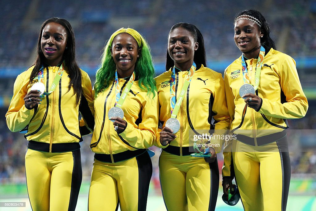 Silver medalists Christania Williams, Elaine Thompson, Veronica Campbell-Brown and Shelly-Ann Fraser-Pryce of Jamaica stand on the podium during the medal ceremony for the Women's 4 x 100 meter Relay on Day 15 of the Rio 2016 Olympic Games at the Olympic Stadium on August 20, 2016 in Rio de Janeiro, Brazil.