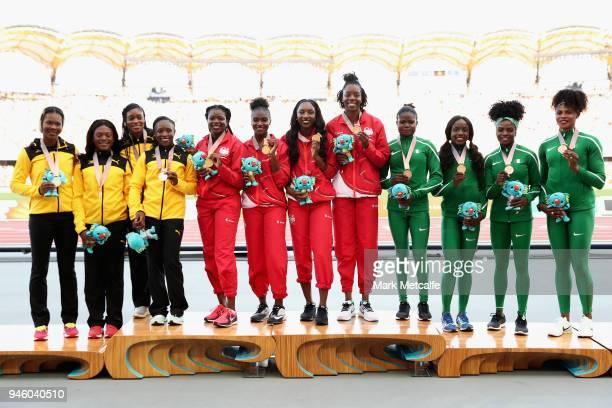 Silver medalists Christania Williams Natasha Morrison Gayon Evans and Elaine Thompson of Jamaica gold medalists Asha Philip Dina AsherSmith Bianca...