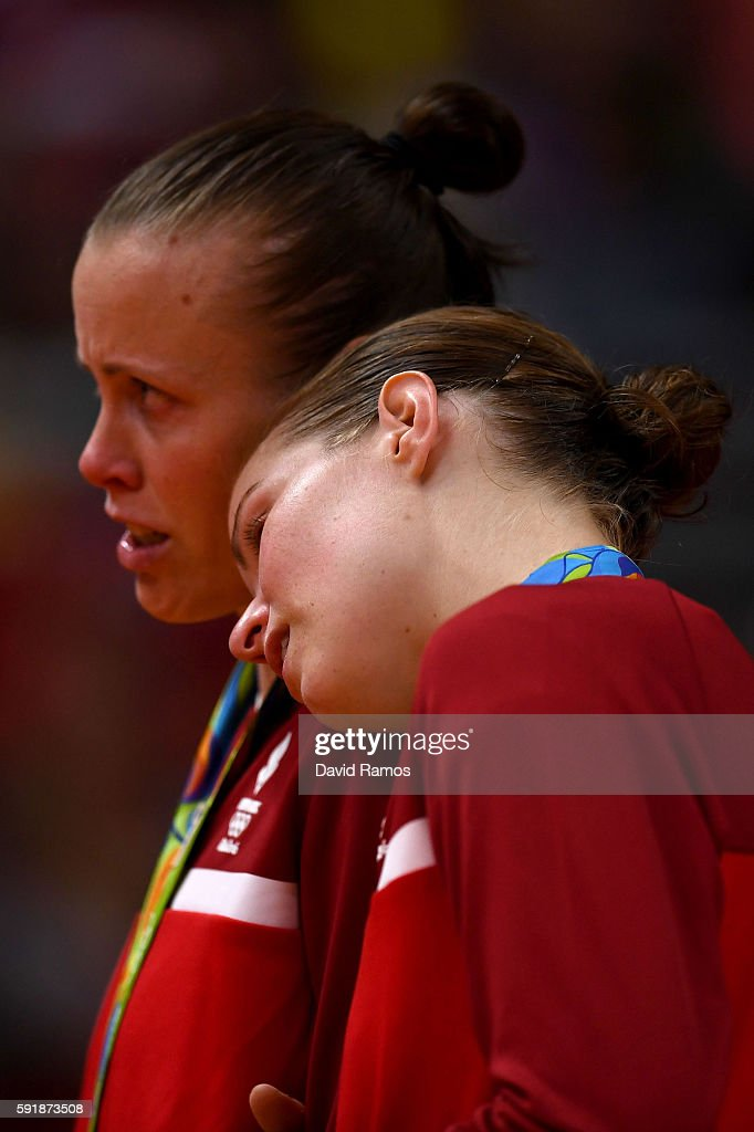 Silver medalists Christinna Pedersen and Kamilla Rytter Juhl of Denmark show their emotion during the medal ceremony for the Women's Doubles Badminton on Day 13 of the Rio 2016 Olympic Games at Riocentro - Pavilion 4 on August 18, 2016 in Rio de Janeiro, Brazil.