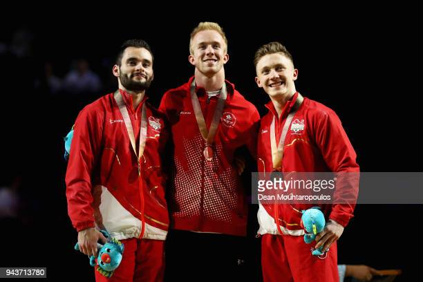 Silver medalists Cory Paterson of Canada and James Hall of England and gold medalist Nile Wilson of England pose during the medal ceremony for the...