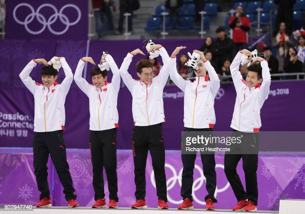 Silver medalists Dajing Wu Tianyu Han Hongzhi Xu Dequan Chen and Ziwei Ren of China celebrate during the victory ceremony after the Short Track Speed...