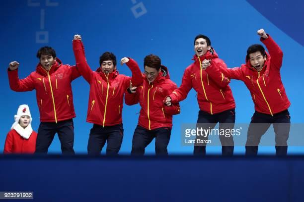 Silver medalists Dajing Wu Tianyu Han Hongzhi Xu Dequan Chen and Ziwei Ren of China celebrate during the medal ceremony for Short Track Speed Skating...
