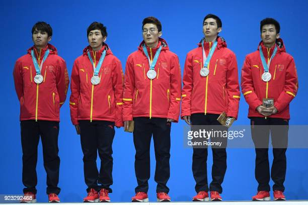 Silver medalists Dajing Wu Tianyu Han Hongzhi Xu Dequan Chen and Ziwei Ren of China stand on the podium during the medal ceremony for Short Track...