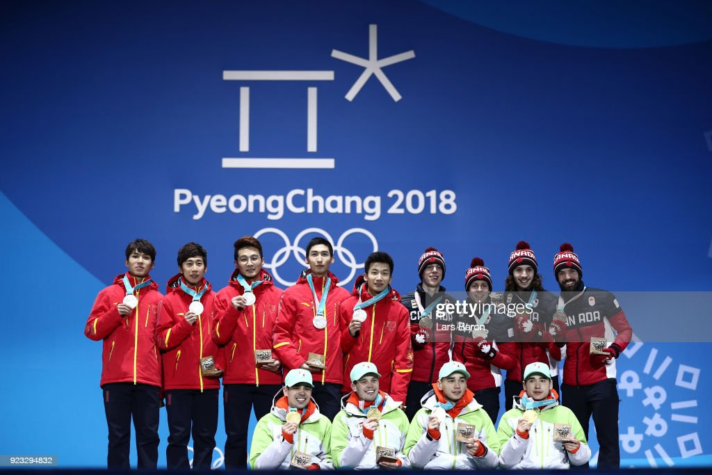 Silver medalists Dajing Wu, Tianyu Han, Hongzhi Xu, Dequan Chen and Ziwei Ren of China, gold medalists Shaoang Liu, Shaolin Sandor Liu, Viktor Knoch and Csaba Burjan of Hungary and bronze medalists Samuel Girard, Charles Hamelin, Charle Cournoyer and Pascal Dion of Canada celebrate during the medal ceremony for Short Track Speed Skating - Men's 5,000m Relay on day 14 of the PyeongChang 2018 Winter Olympic Games at Medal Plaza on February 23, 2018 in Pyeongchang-gun, South Korea.