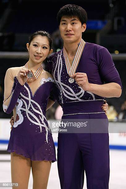 Silver medalists Dan Zhang and Hao Zhang of China pose with their medals after the Pairs Free Skate during the 2009 ISU World Figure Skating...