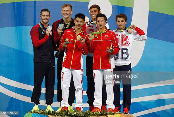 Silver medalists David Boudia and Steele Johnson of the United States gold medalists Aisen Chen and Yue Lin of China and bronze medalists Daniel...