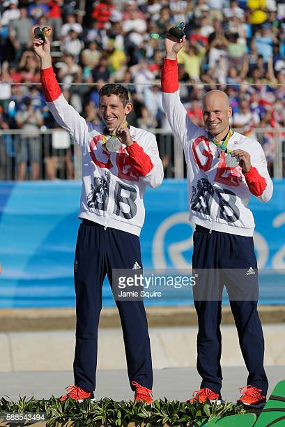 Silver medalists David Florence and Richard Hounslow of Great Britain celebrate on the podium at the medal ceremony for the Men's Canoe Double on Day...