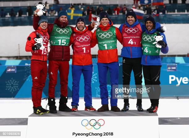 Silver medalists Denis Spitsov and Alexander Bolshunov of Olympic Athlete from Russia gold medalists Martin Johnsrud Sundby and Johannes Hoesflat of...