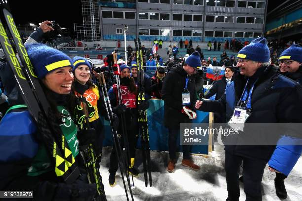 Silver medalists Ebba Andersson Charlotte Kalla and Anna Haag of Sweden celebrate with King Carl Gustaf of Sweden after the Ladies' 4x5km Relay on...