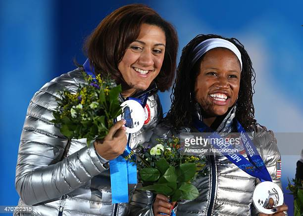 Silver medalists Elana Meyers and Lauryn Williams of the United States team 1 celebrate during the medal ceremony for the Women's Bobsleigh on day...