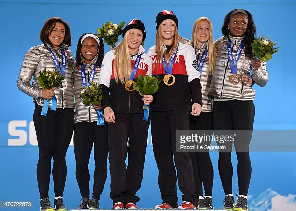 Silver medalists Elana Meyers and Lauryn Williams of the United States team 1 gold medalists Kaillie Humphries and Heather Moyse of Canada team 1 and...