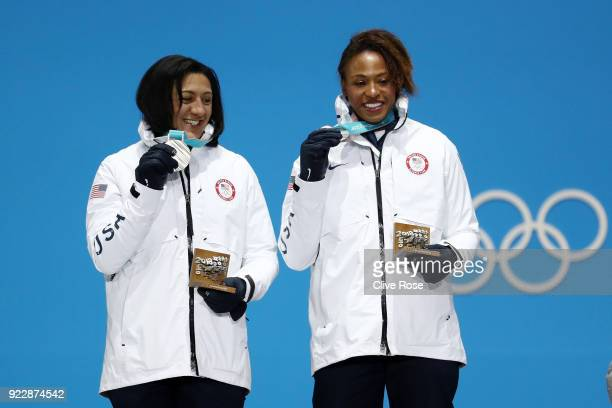 Silver medalists Elana Meyers Taylor and Lauren Gibbs of the United States celebrate during the medal ceremony for Bobsleigh Women on day 13 of the...