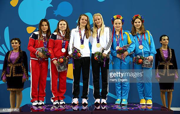 Silver medalists Elena Chernykh and Maria Polykova of Russia gold medalist Saskia Oettinghaus and Louisa Stawczynski oof Germany and bronze medalists...