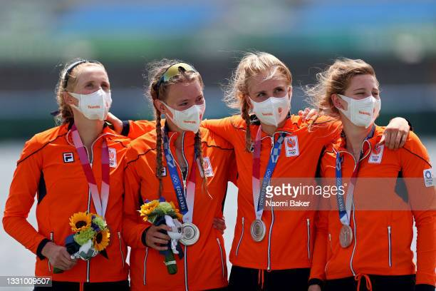 Silver medalists Ellen Hogerwerf, Karolien Florijn, Ymkje Clevering and Veronique Meester of Team Netherlands pose with their medals during the medal...