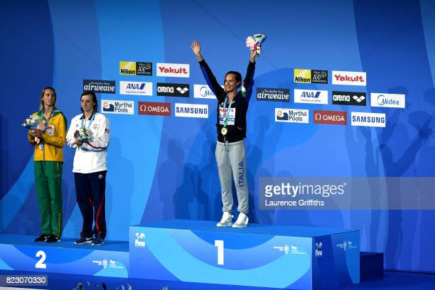 Silver medalists Emma Mckeon of Australia and Katie Ledecky of the United States and gold medalist Federica Pellegrini of Italy pose with the medals...